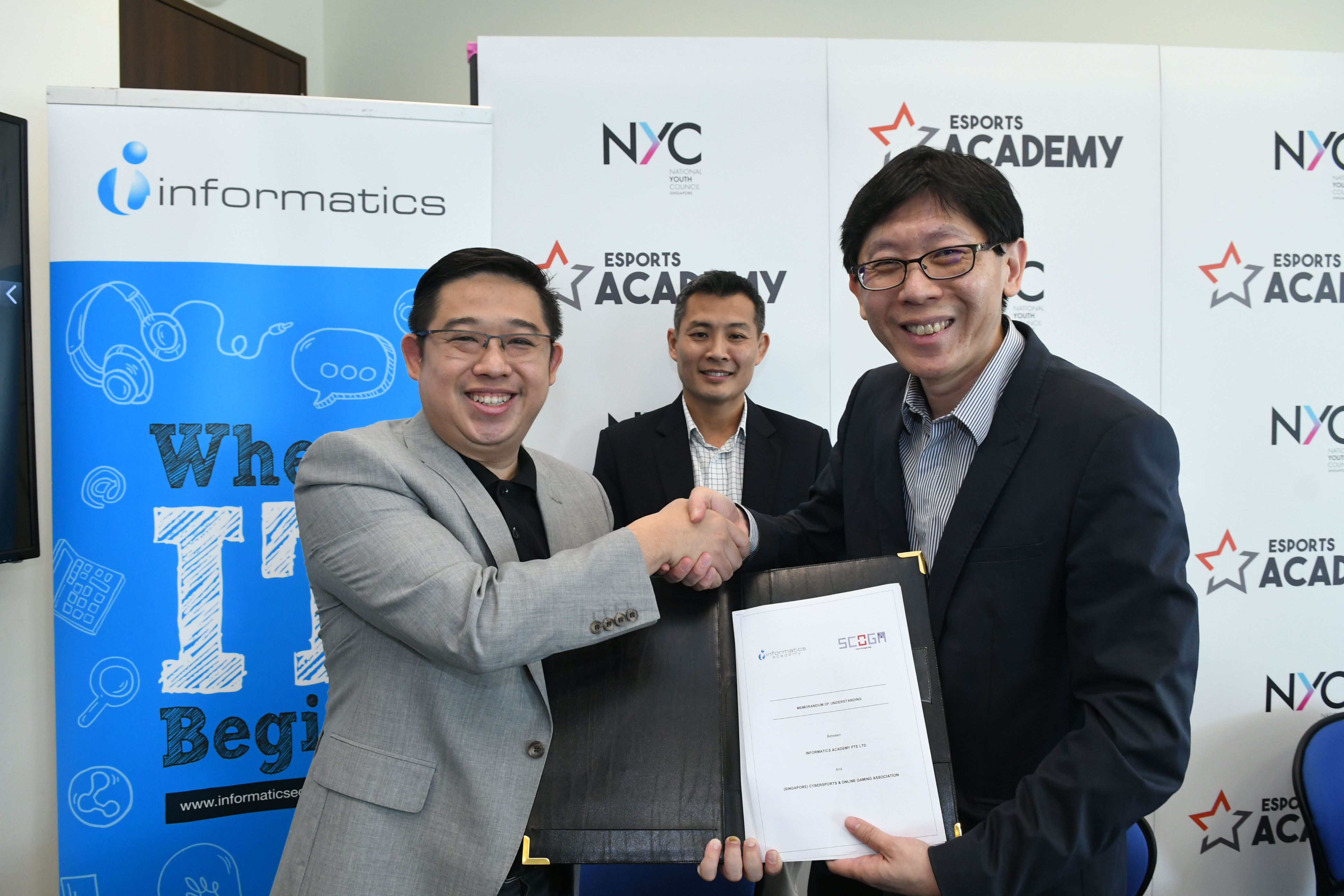 (3) SCOGA And Informatics Academy Handshake At Signing Ceremony & Launch Of Esports Academy